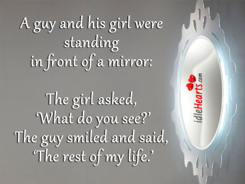 A Guy And His Girl Were Standing In Front Of A Mirror: