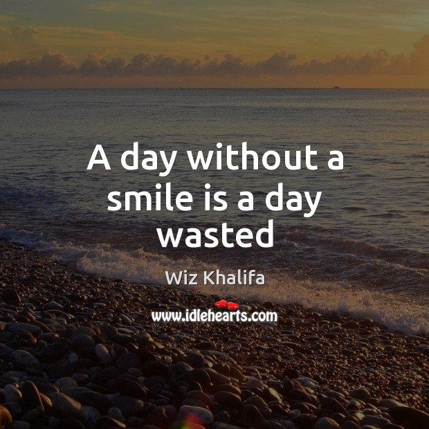 A day without a smile is a day wasted Smile Quotes Image
