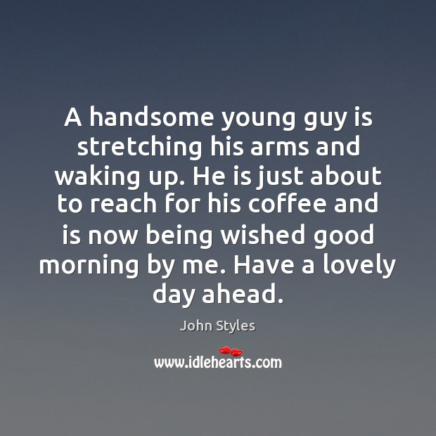 A handsome young guy is stretching his arms and waking up. He Image