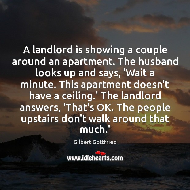 A landlord is showing a couple around an apartment. The husband looks Image
