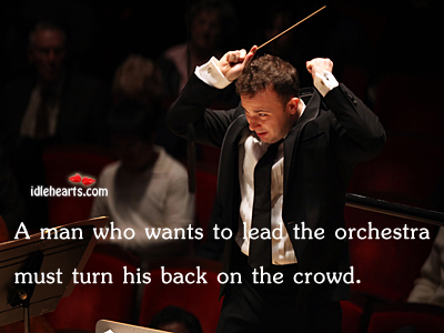 A man who wants to lead the orchestra must Image