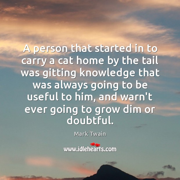 A person that started in to carry a cat home by the Image