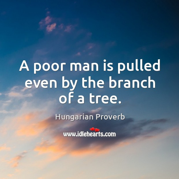A poor man is pulled even by the branch of a tree. Image