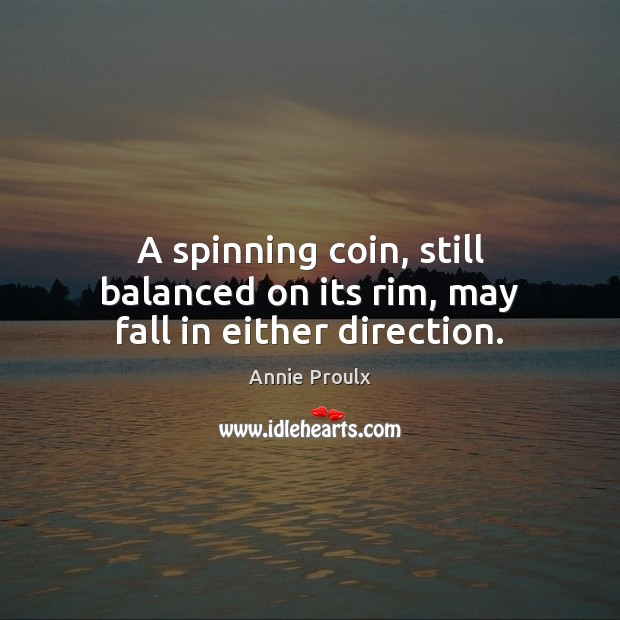 Image, A spinning coin, still balanced on its rim, may fall in either direction.