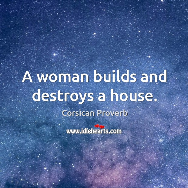 A woman builds and destroys a house. Image