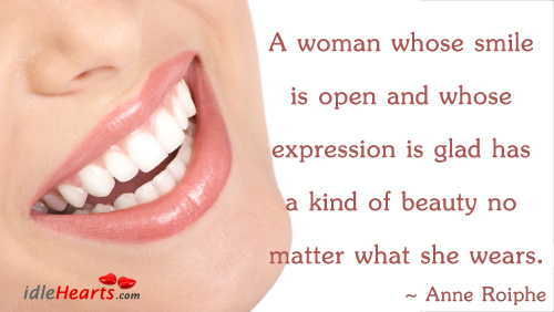 Image, A woman whose smile is open and whose