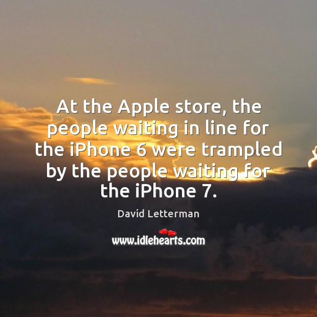 At the Apple store, the people waiting in line for the iPhone 6 Image