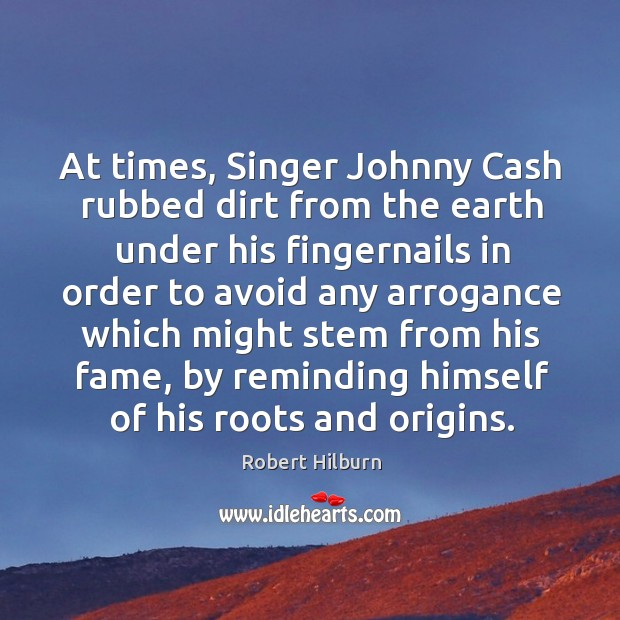 At times, Singer Johnny Cash rubbed dirt from the earth under his Image