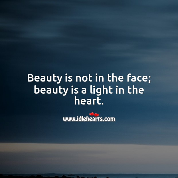 Beauty is not in the face; beauty is a light in the heart. Inspirational Love Quotes Image