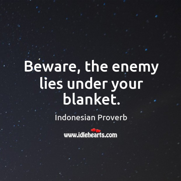 Beware, the enemy lies under your blanket. Indonesian Proverbs Image