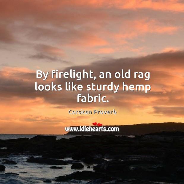 By firelight, an old rag looks like sturdy hemp fabric. Image