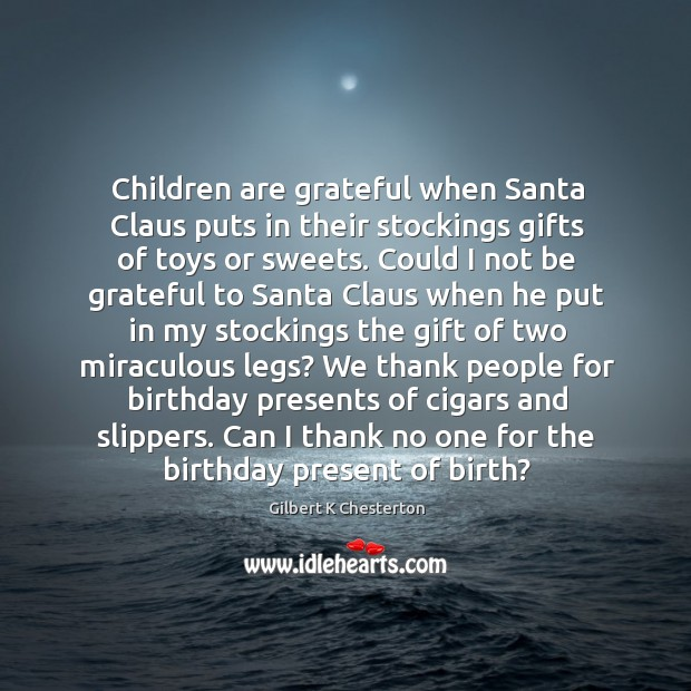 Children are grateful when Santa Claus puts in their stockings gifts of Image