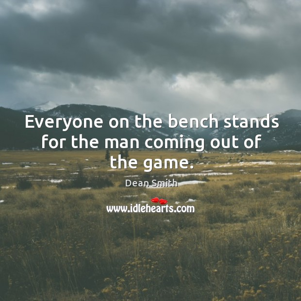 Image, Everyone on the bench stands for the man coming out of the game.