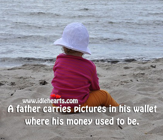 A father carries pictures in his wallet where his money used to be. Image