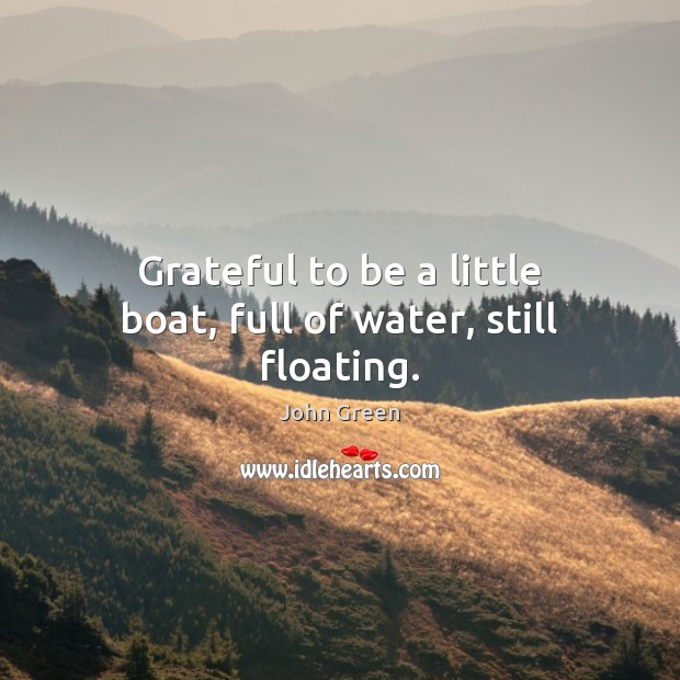 Grateful to be a little boat, full of water, still floating. Image