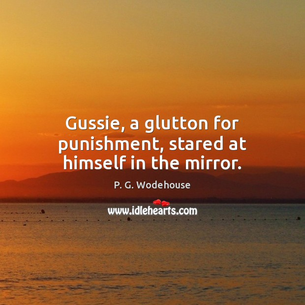 Gussie, a glutton for punishment, stared at himself in the mirror. Image