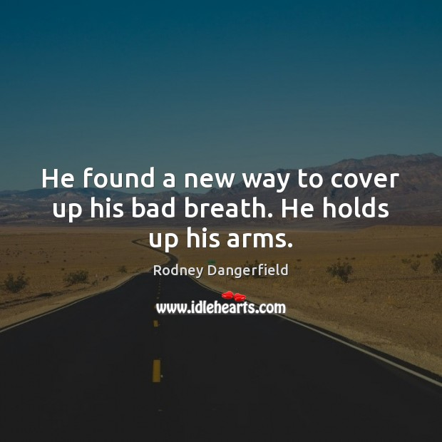 He found a new way to cover up his bad breath. He holds up his arms. Image