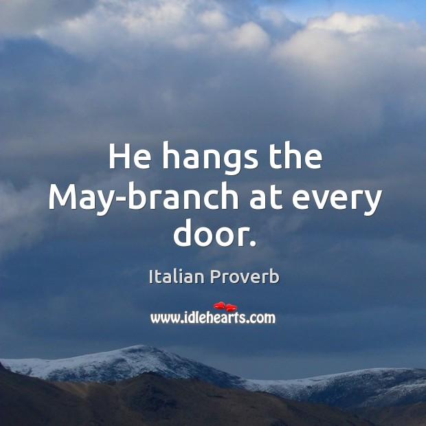 He hangs the may-branch at every door. Image