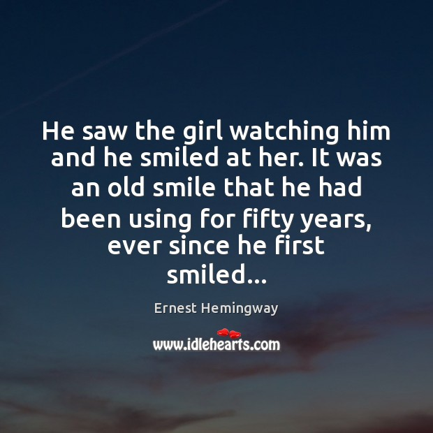 He saw the girl watching him and he smiled at her. It Image