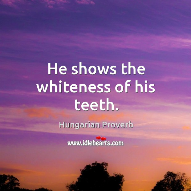 He shows the whiteness of his teeth. Image