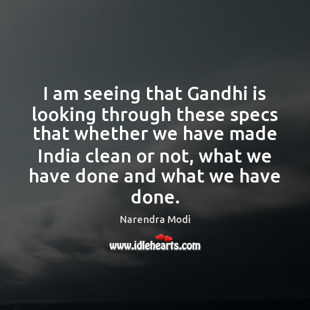 Image, I am seeing that Gandhi is looking through these specs that whether