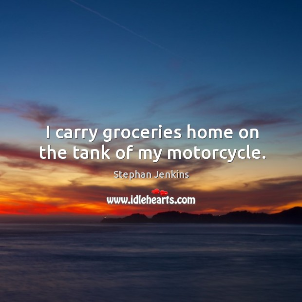 I carry groceries home on the tank of my motorcycle. Image