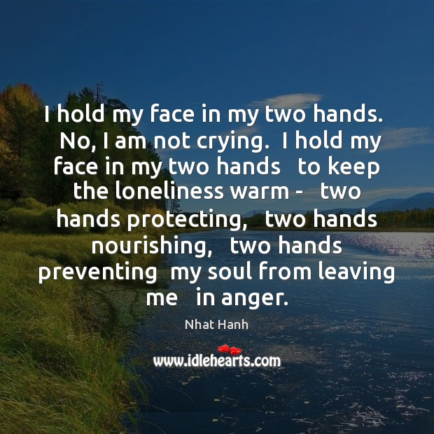 Image, I hold my face in my two hands.   No, I am not
