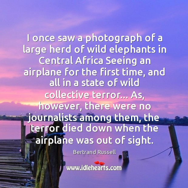 I once saw a photograph of a large herd of wild elephants Image