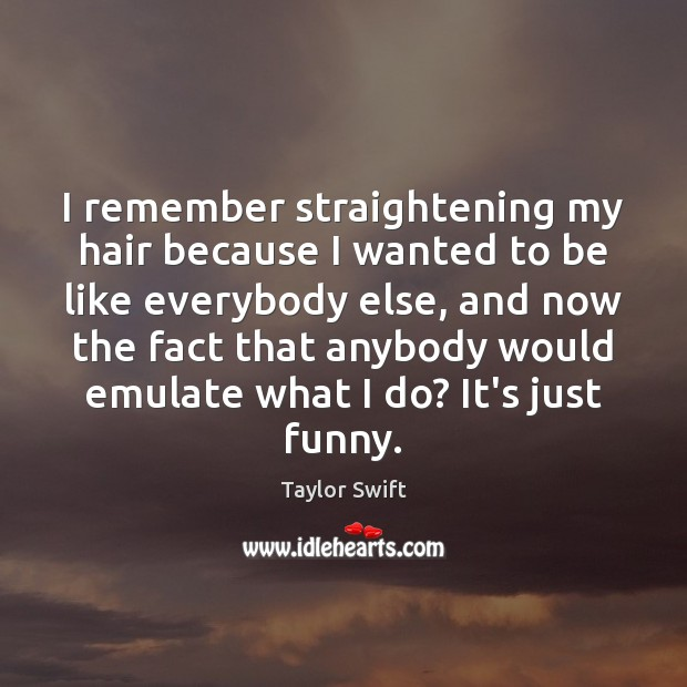 I remember straightening my hair because I wanted to be like everybody Image