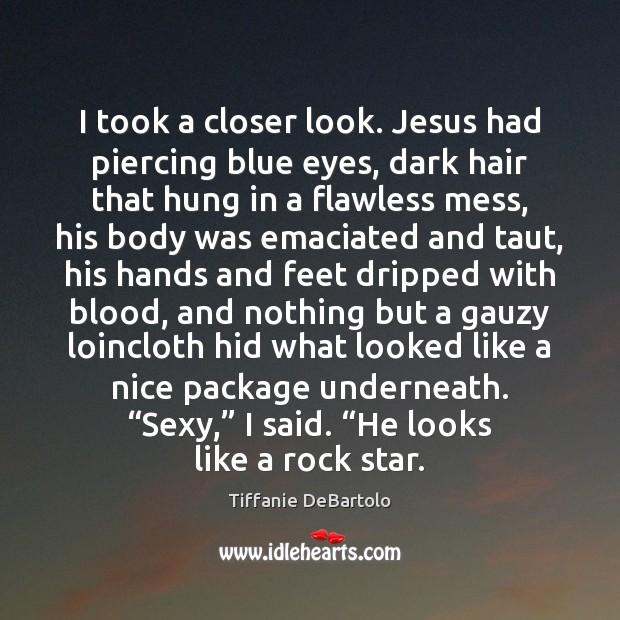 I took a closer look. Jesus had piercing blue eyes, dark hair Image