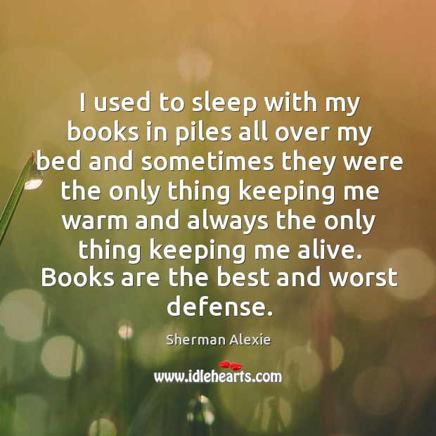 Image, I used to sleep with my books in piles all over my