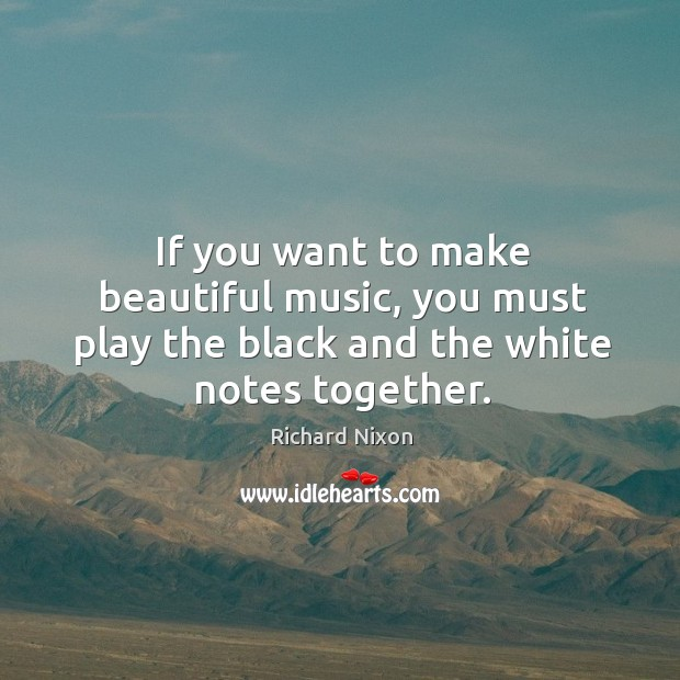 If you want to make beautiful music, you must play the black and the white notes together. Image