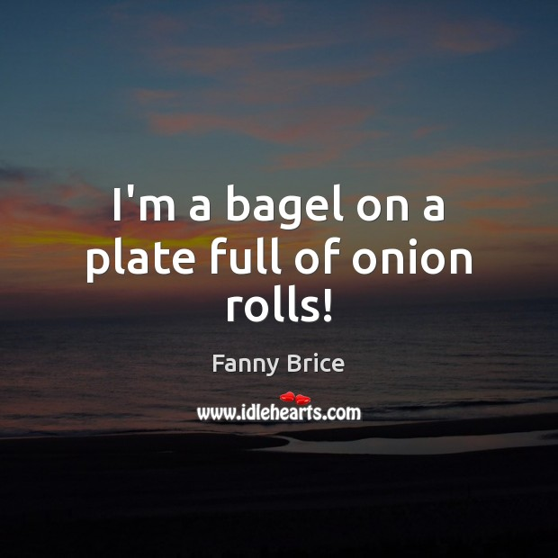 I'm a bagel on a plate full of onion rolls! Image