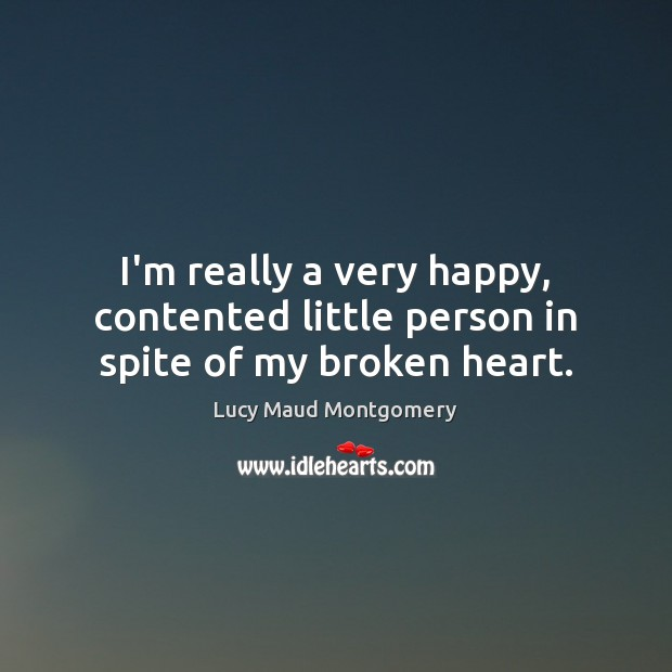 I'm really a very happy, contented little person in spite of my broken heart. Image