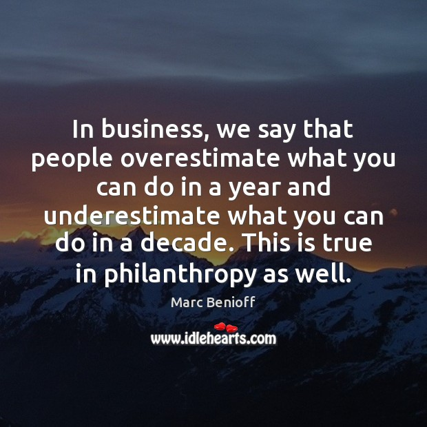 In business, we say that people overestimate what you can do in Marc Benioff Picture Quote