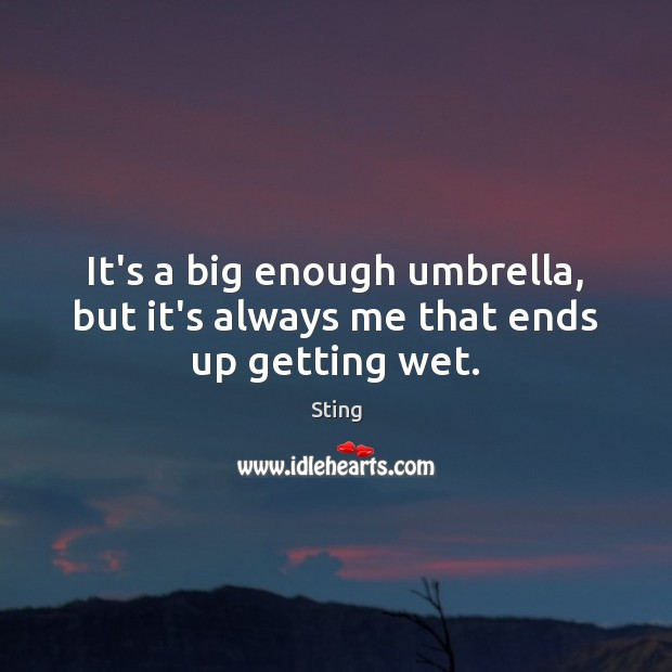 It's a big enough umbrella, but it's always me that ends up getting wet. Image