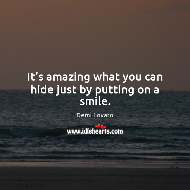 It's amazing what you can hide just by putting on a smile. Image