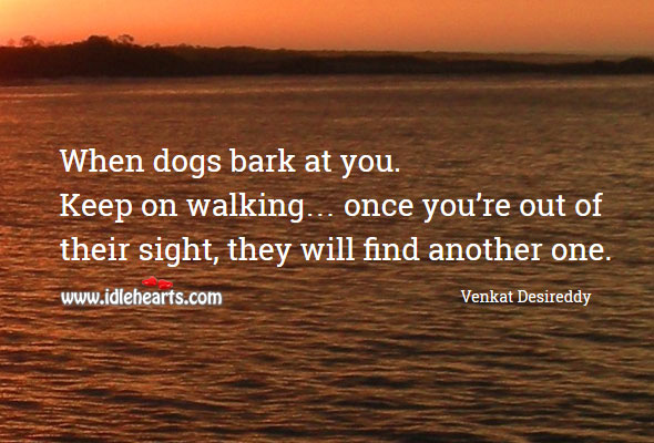 Image, When dogs bark at you. Keep on walking