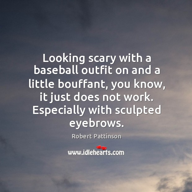 Looking scary with a baseball outfit on and a little bouffant, you Image