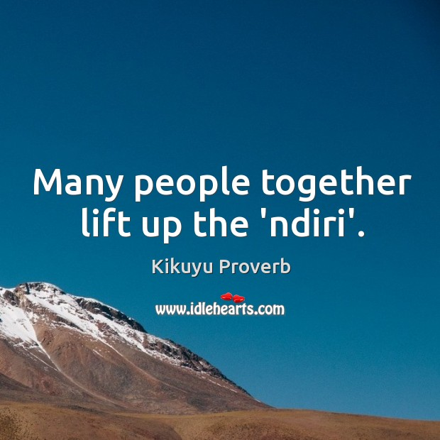 Many people together lift up the 'ndiri'. Image
