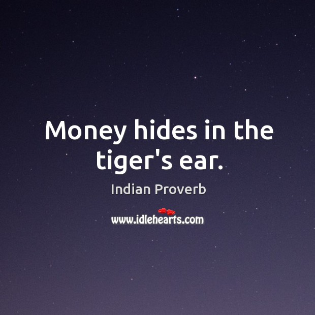 Money hides in the tiger's ear. Image