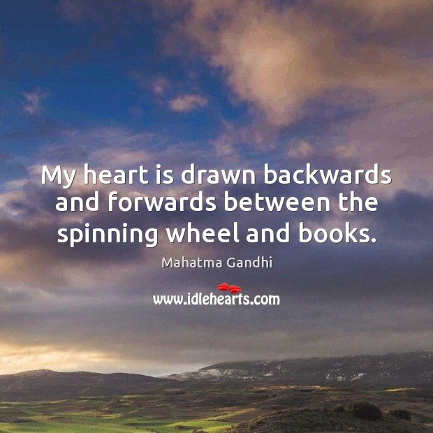 Image, My heart is drawn backwards and forwards between the spinning wheel and books.
