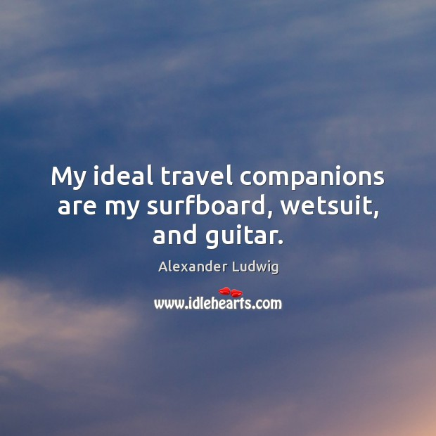 Image, My ideal travel companions are my surfboard, wetsuit, and guitar.