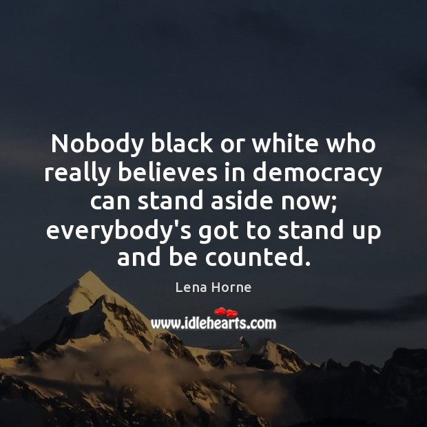 Image, Nobody black or white who really believes in democracy can stand aside