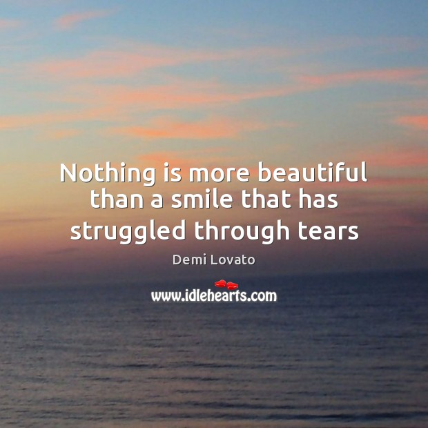 Nothing is more beautiful than a smile that has struggled through tears Image