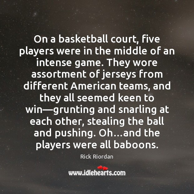 On a basketball court, five players were in the middle of an Image