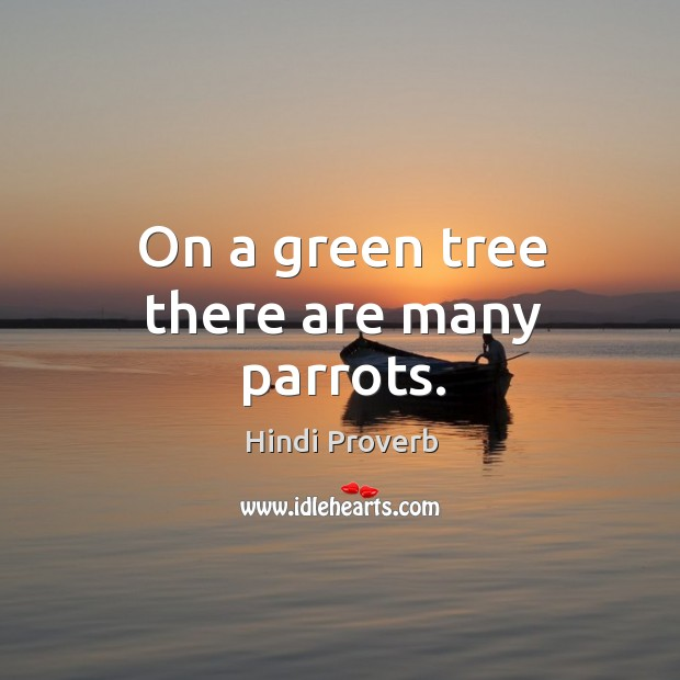 On a green tree there are many parrots. Hindi Proverbs Image