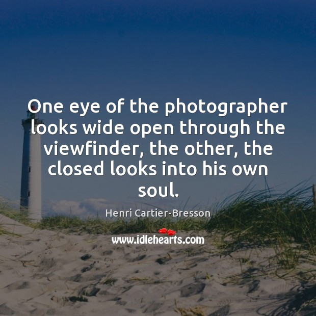 Image about One eye of the photographer looks wide open through the viewfinder, the