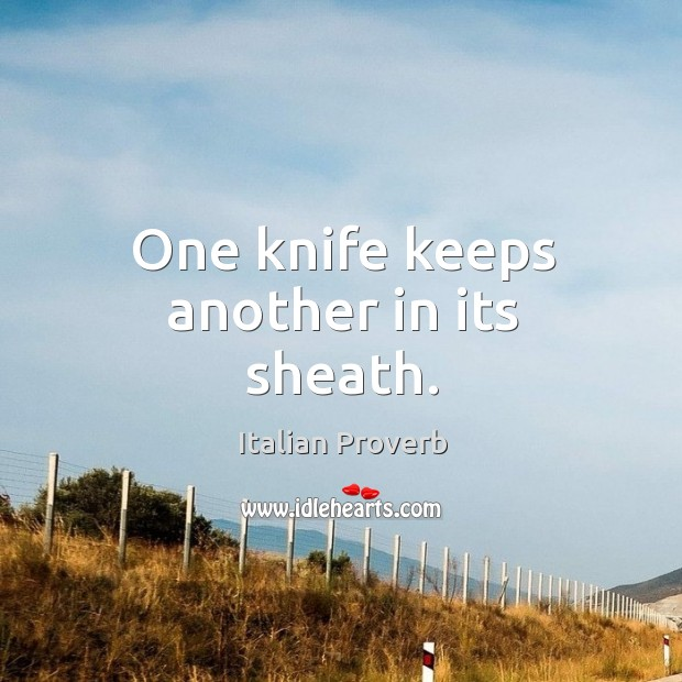 Image, One knife keeps another in its sheath.