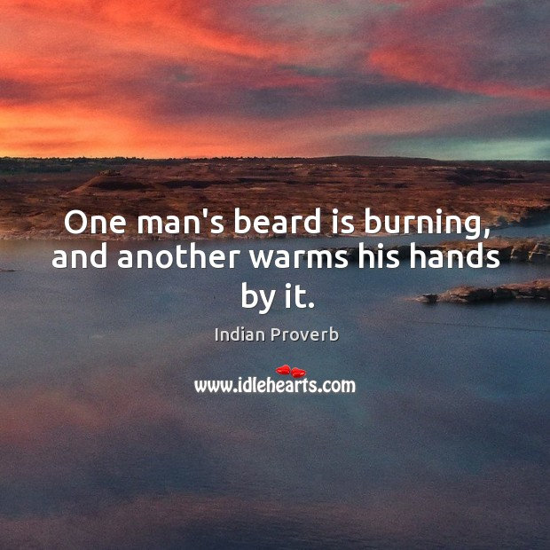 One man's beard is burning, and another warms his hands by it. Indian Proverbs Image